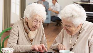 Two-Senior-Women-Playing-Dominoes-shutterstock