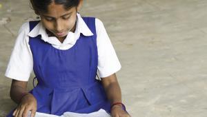 Indian schoolgirl reading
